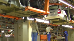 People work at assembly of cars Lada Kalina Stock Footage