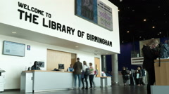 The Library of Birmingham - welcome help desk. Stock Footage