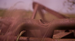 Rusty Equipment in a Field 2 Stock Footage