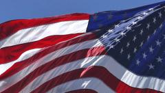 USA Flag - Waving On Blue Sky - Slow Motion Stock Footage