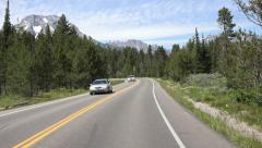Driving Grand Teton NP forest to mountain POV fast motion 4K Stock Footage