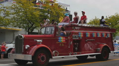 Fire truck float in front of Center GLBT gay community during Pride parade Stock Footage