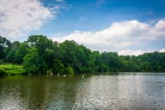 Lake Roland, at Robert E. Lee Park in Baltimore, Maryland. - stock photo