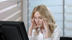 Tired business woman drinking coffee. His eyes are sore from the computer. Stock Footage