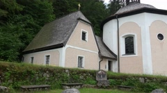 4k Small romantic church on mountain in Hallstatt Austria Stock Footage