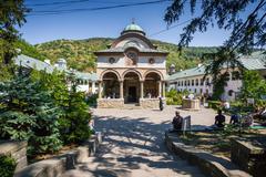 Cozia monastery church with visiting tourists Stock Photos