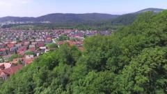 AERIAL: Beautiful suburban town in the middle of nature - stock footage