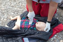 Infant dummy first aid Stock Photos