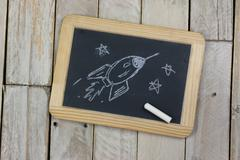 Small blackboard with white chalk - stock photo