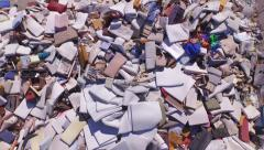 AERIAL: Big piles of old mattresses and sofas in the garbage dump Stock Footage