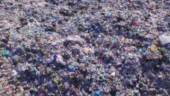AERIAL: Big piles of empty bottles, bags and other plastic in the garbage dump Stock Footage
