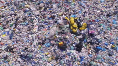 AERIAL: Endless pile of plastic bottles, bags and other waste Stock Footage