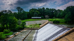 Timelapse footage of a dam and Lake Roland at Robert E. Lee Park in Baltimore - stock footage