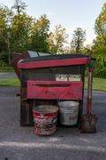 A dumpster with buckets with disposing of campfire ashes - stock photo