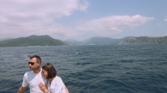 Couple in love on a yacht at sea. Boat traveling on the islands. Luxury holidays Stock Footage
