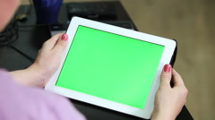 Unrecognizable Caucasian woman holding tablet in hands with green screen chroma Arkistovideo