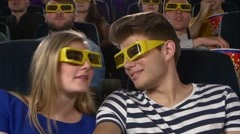 Couple in cinema watching a movie with 3D glasses. Close Up Stock Footage