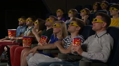 Young people watch movies in cinema:  comedy in 3D - stock footage