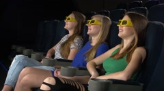 Young friends watching a film at the cinema, 3d glasses Stock Footage