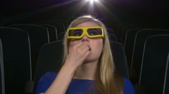 Attractive young girl in 3D at the cinema. eating popcorn. Close up Stock Footage