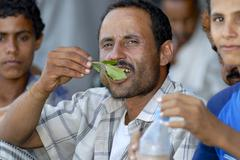 Man chews khat (Catha edulis) at the local market in Lahij, Yemen. Stock Photos