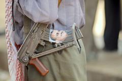 Yemeni man holds Kalashnikov machine gun, Hadramaut valley, Yemen. Stock Photos