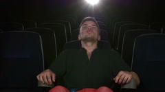 Boy sitting at cinema, Close up Stock Footage