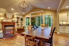 Well lit dinning room with connected living room. - stock photo