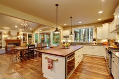 Classic kitchen with hardwood floor and an island. - stock photo