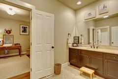 Classic bathroom connected to room. Stock Photos