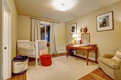 Nice baby room with hardwood floor. - stock photo