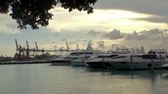 Yachts on the Miami Beach Marina with the cargo port on background. Stock Footage