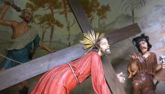 Jesus torture figures pan mountain church Hallstatt Stock Footage