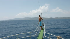Young man standing in front of the ship during the voyage of the ship at sea Stock Footage