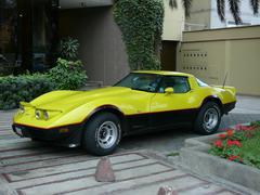 Yellow and black Chevrolet Corvette in Lima - stock photo