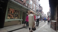 Stock Video Footage of York, England, 22 June, 2015, visitors walking along the old streets, HD footage