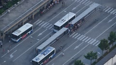Aerial view of Shanghai bus station,people up and down.time lapse Stock Footage