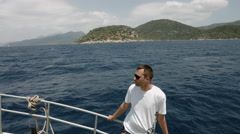 Man on sailboat, relaxation in luxury sea cruise, summertime leisure time on Stock Footage