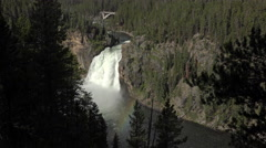 Upper Falls Yellowstone River through forest rainbow 4K Stock Footage
