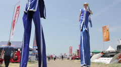 Man and woman on stilts Stock Footage
