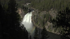 Upper Falls Yellowstone River through forest rainbow fast 4K Stock Footage