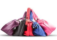 Strack of luxury fashion female handbag on white background Stock Photos