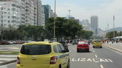 Driving Through Rio de Janeiro. Brazil. Copacabana Beach. Zona Sul. Yellow taxi Stock Footage