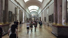 Visitors Walking in the Louvre museum of Paris Stock Footage