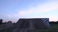 Bar Spin BMX Stunt Riding - Cyclists Jumping Big Dirt Jumps Stock Footage