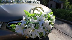 Wedding rings decorated with flowers on car after the rain Stock Footage