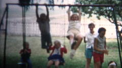 (8mm Vintage) 1962 Kids Wildly Playing On Swingset. Iowa, USA. - stock footage