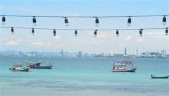 Boats in Pattaya bay. Background is Pattaya city shooting from Koh Lan Island. - stock footage