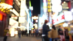 Dotonbori area shopping street and landmark at night blurry - stock footage