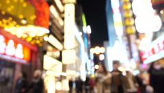 Dotonbori area shopping street and landmark at night blurry Stock Footage